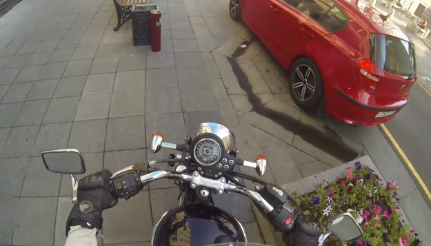 A Woman On A Motorbike Is Chasing Down People Who Drop Litter And Throwing It Back At Them
