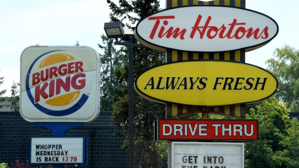Burger King buying Tim Hortons for about $11B; new co. to be based in Canada